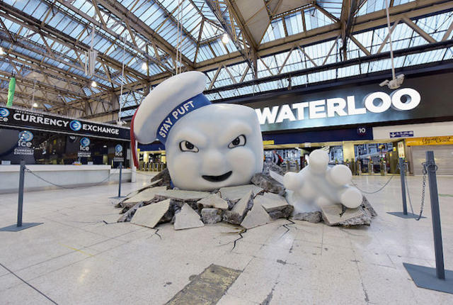 LONDON, ENGLAND - JULY 11:  Stay Puft Marshmallow Man is seen on the concourse at Waterloo Station on July 11, 2016 in London, England. Ghostbusters take over Waterloo Station as Stay Puft Marshmallow Man smashes through the concourse during the morning rush-hour. Standing at 2.9m in height with a circumference of 8.5m commuters come face-to-face with the mammoth menace. Ghostbusters is in cinemas from today.  (Photo by Gareth Cattermole/Getty Images for Sony Pictures)